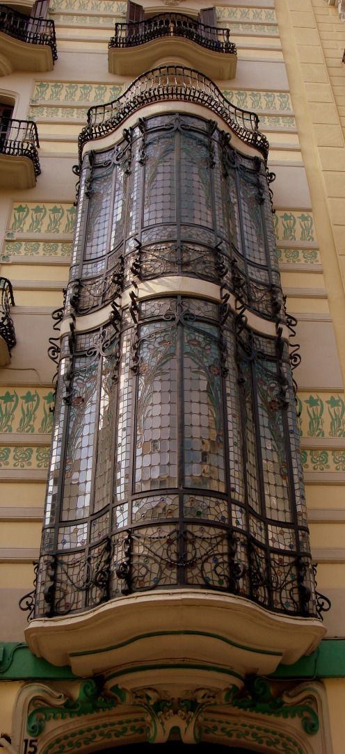 spectacular colored stained-glass windows, beautifully integrated with curves of  iron ware with pastroral details. they show the best samples of the Art nouveau elegance