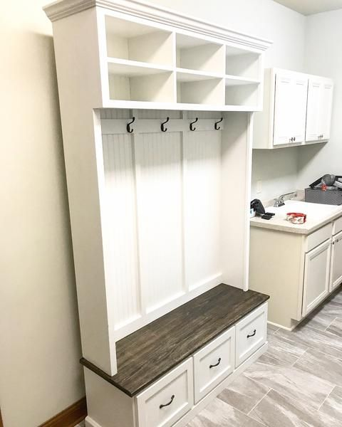 Entryway bench with shoe storage, coat rack and storage compartments ...