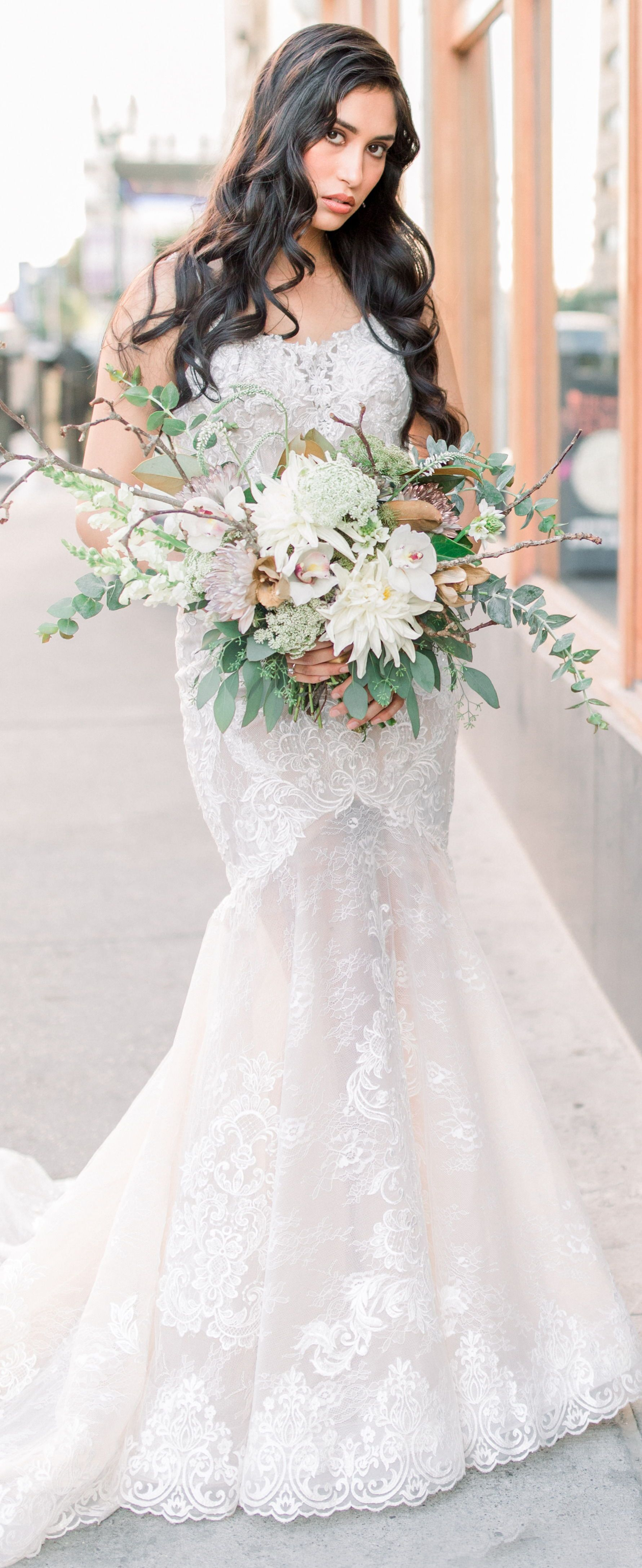 Lace Mermaid Wedding Dress By David S Bridal With Trumpet Skirt Paired With An Organic Wild Bouquet Wedding Dresses Latest Wedding Gowns Fitted Wedding Dress [ 4346 x 1781 Pixel ]