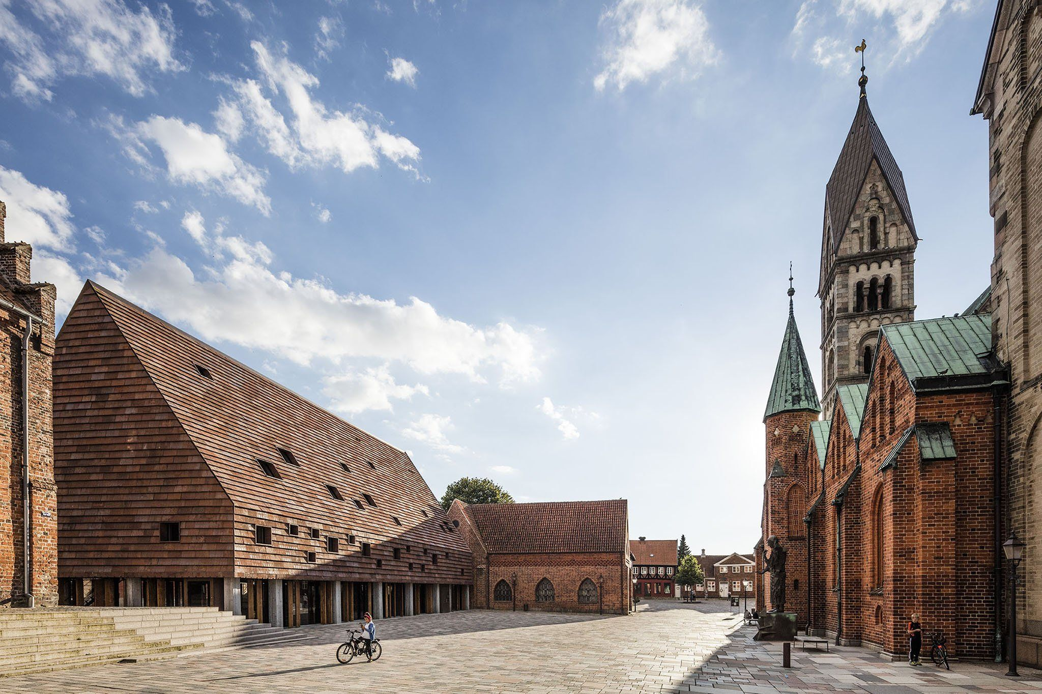 5 finalists. Kannikegården with Ribe Cathedral in foreground. Kannikegården, new church hall by Lundgaard & Tranberg Arkitekter. Image © Anders Sune Berg.