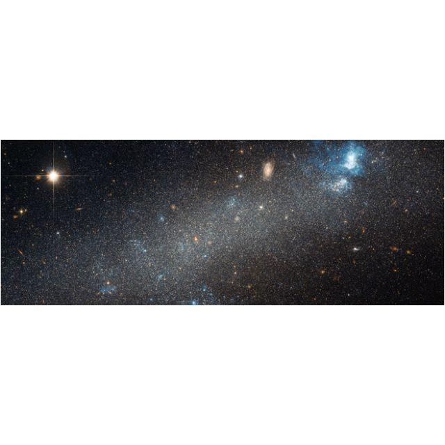 Hubble divulga imagem inédita de galáxia anã. Galáxia NGC 2366 fica a 10 milhões de anos-luz da Terra.