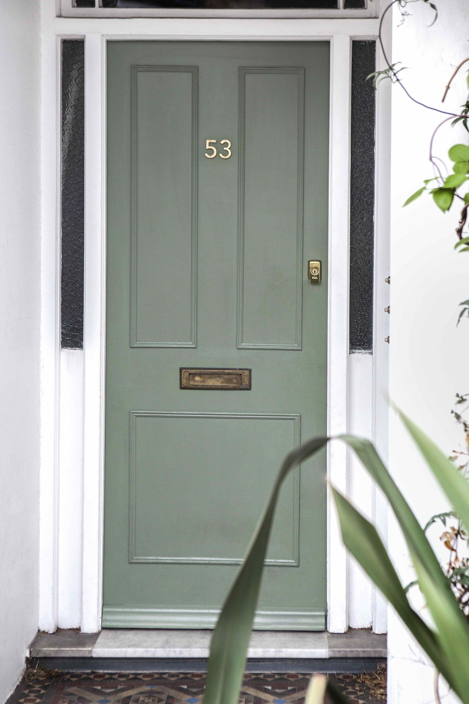 Cast bronze door numbers in situ