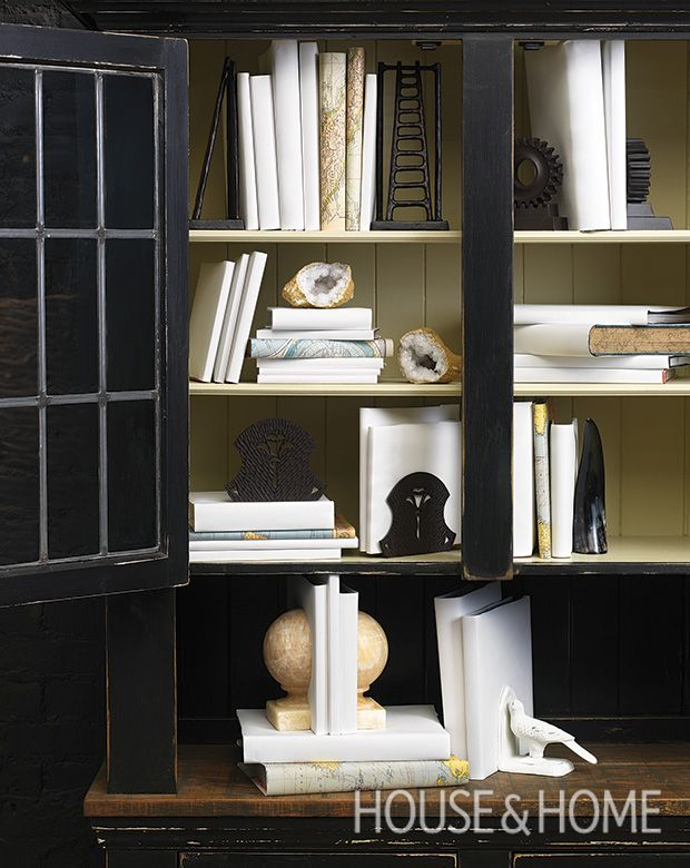 There is no topping the beauty of nature when it comes to design, so incorporating items such as geodes, shells, or even resin coral replicas lends a softness to the (manmade) hard lines of shelves and books.   Photographer: Mark Burstyn