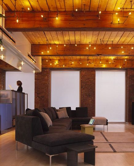 Sofas, Brick & Glass Wall, Exposed Beam And Pipe Lights