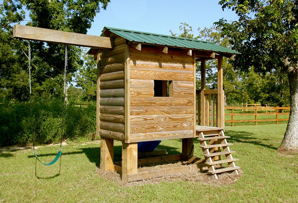 Log Cabin Playhouse with Swing made with YellaWood