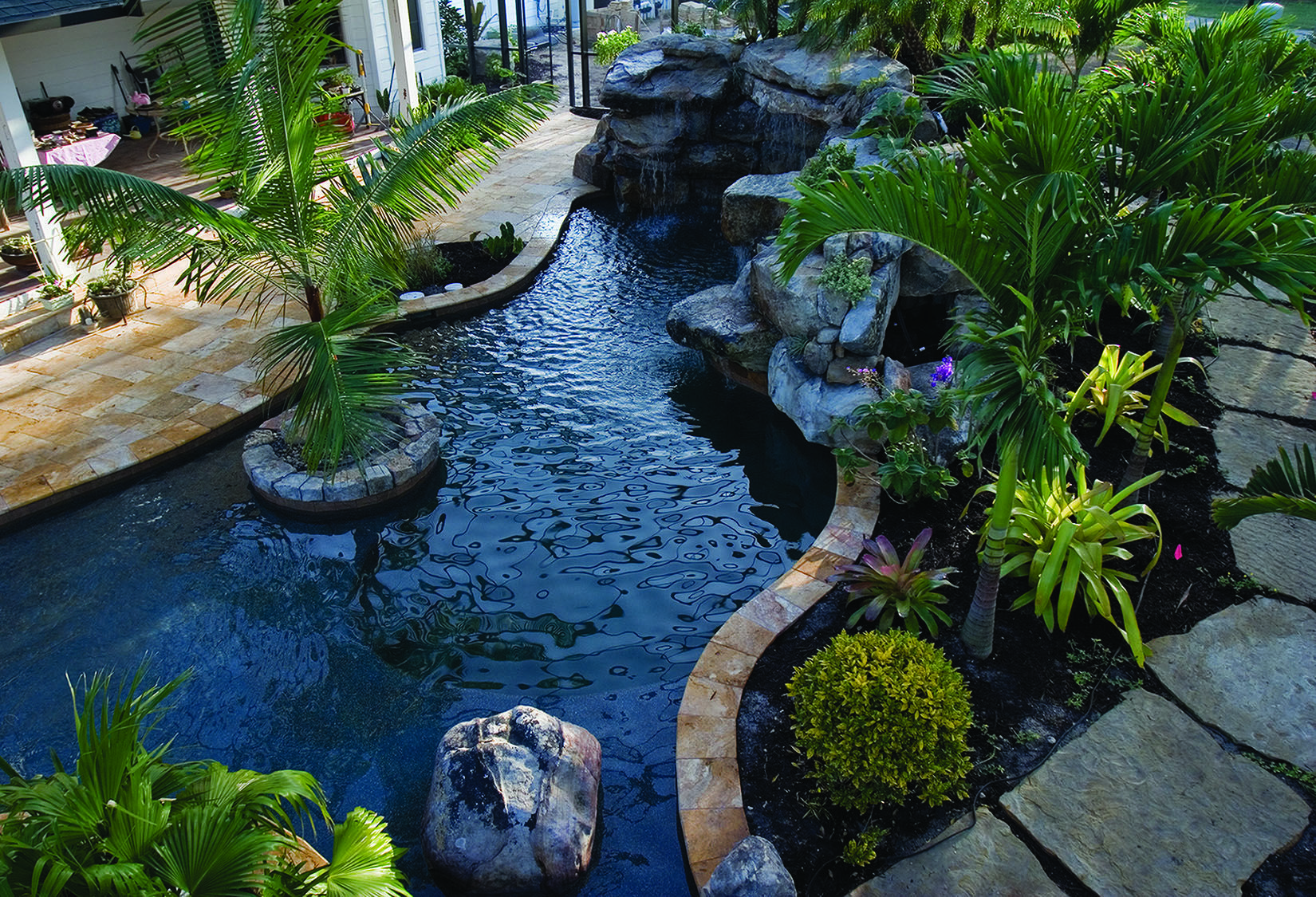 Lagoon Pool Designs | Lagoon Pool with an Outdoor Kitchen and Bar ...