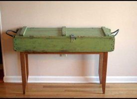 "Wow - Tim Sway Perspectives through Custommade.com , made this brilliant sofa table/side table, out of a ""vietnam war era us military ammunition/rifle box and reclaimed cherry base"".  I guess that anything with a large, flat surface will do - suitcases, drawers, shelves, etc"