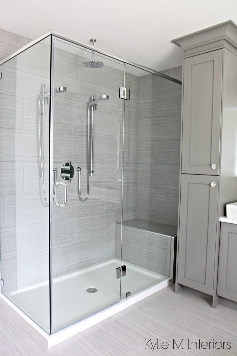 Master Shower With Bench And 2 Shower Heads Next To Stand Alone