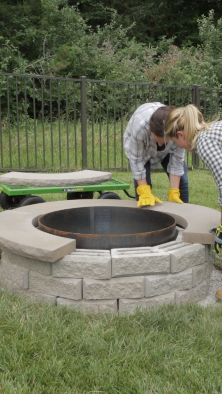 Get ready for months of outdoor fun around your new backyard DIY fire pit. Build this easy DIY fire pit your whole family will enjoy for years to come. #weekendprojects #backyardmakeover #landscaping #diyfirepit #bhg