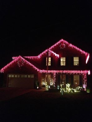 """""""For Christmas, my husband created a beautiful, whimsical """"pink"""" tree, complete with pink lights, and decorated the outside of our home in pink and white décor, complete with """"pink"""" icicle lights, again, to brighten my day as I continue my chemo treatments during the Christmas holiday season.""""  Thanks for sharing, Susan!"""