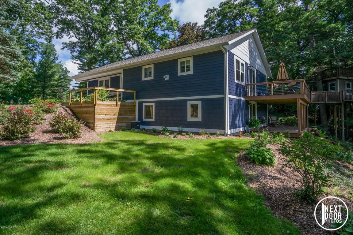 14530 128th Avenue, Grand Haven, MI 49417 recreational paradise on 5.6 acres of land. Let's start with the highlights; 2,000 sf Ranch home, 1,330 sf guest quarters, tree house w/electricity, above ground pool w/decking, 3-stall horse barn, riding arena, 4-garage stalls and a pond with waterfall. This 3 bedroom, 2.5 bath, newly constructed ranch home has everything you'd ever need with the potential to grow.