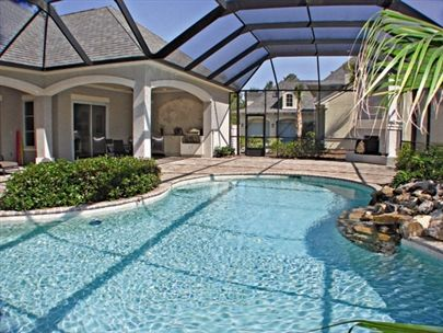 Screened lanai with pool waterfall and kitchen dream for Florida lanai designs
