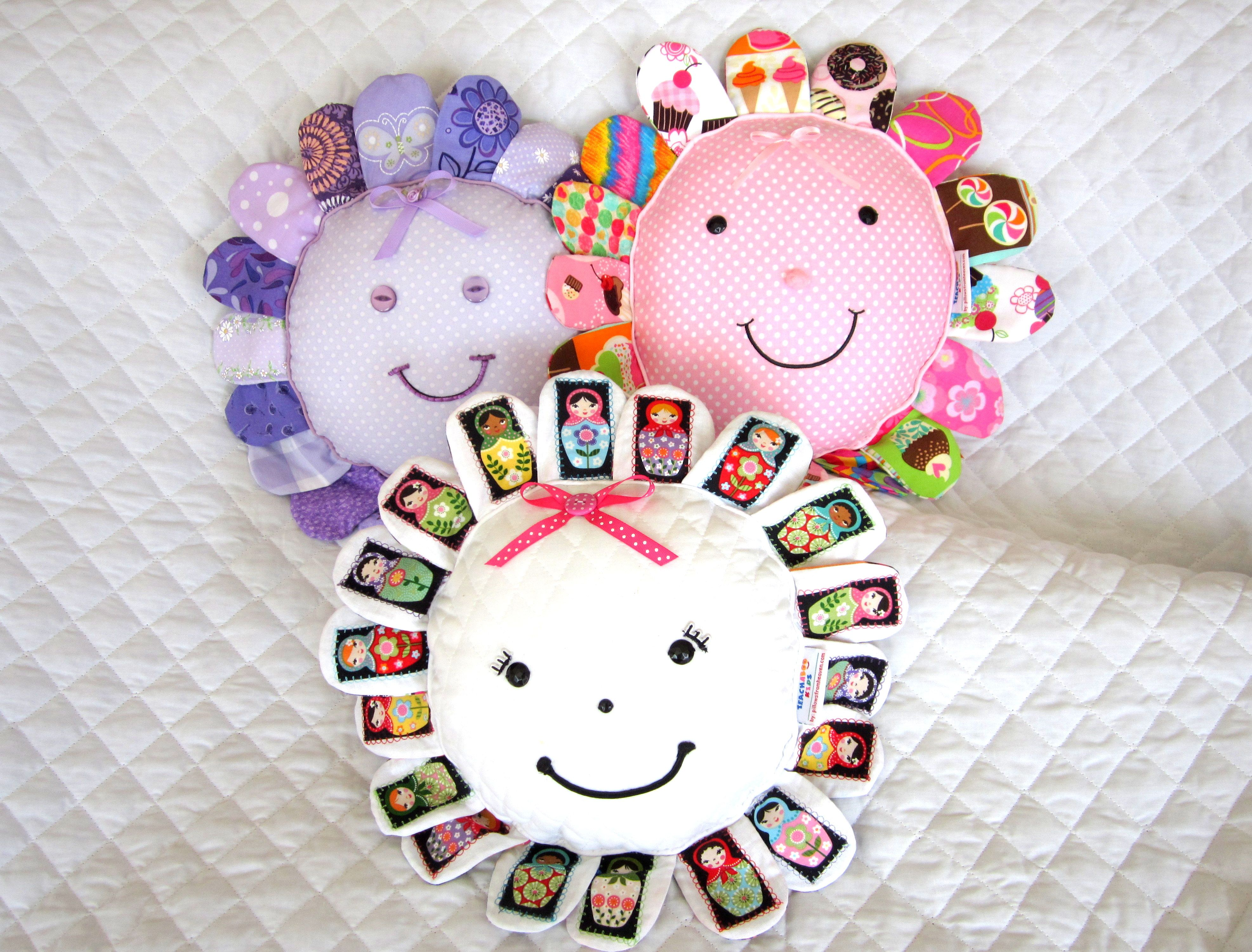 Happy Flappy pillows for girls --  Hang them on a wall or toss them on the bed. Their smiling faces are sure to brighten your little girl's room.