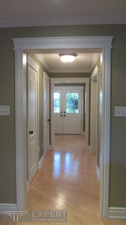 Crown Moulding, Door Casings, Door Headers And Baseboard. I Like The Look  Of The Blond Hardwood Floors With The Painted Walls.