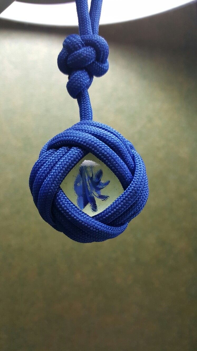 Celtic button knot over marble | MY Paracord Knots