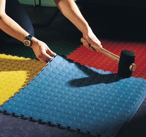 turn garage into a daycare Using rubber tile to garage floor