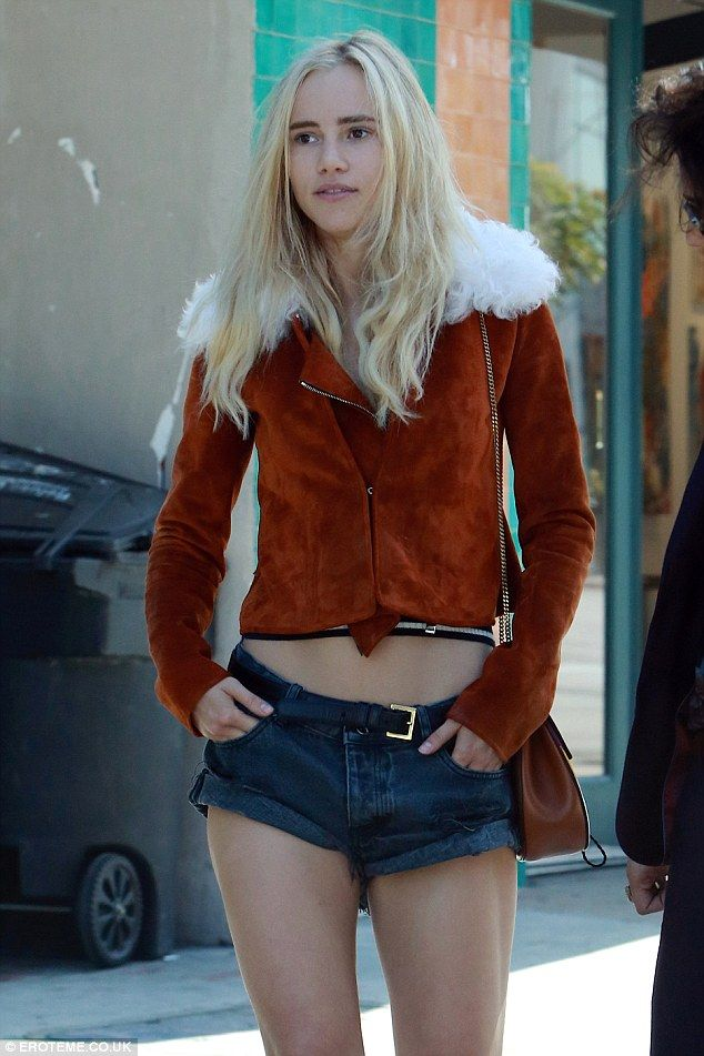 Blond(er) beauty:The 24-year-old model was dressed to impressed in a pair of thigh-skimming Daisy Dukes with a Seventies-inspired shearling coat