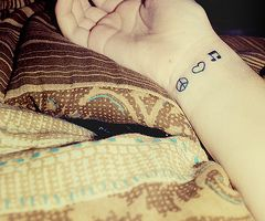 Got this on my left wrist as my first tattoo! :]
