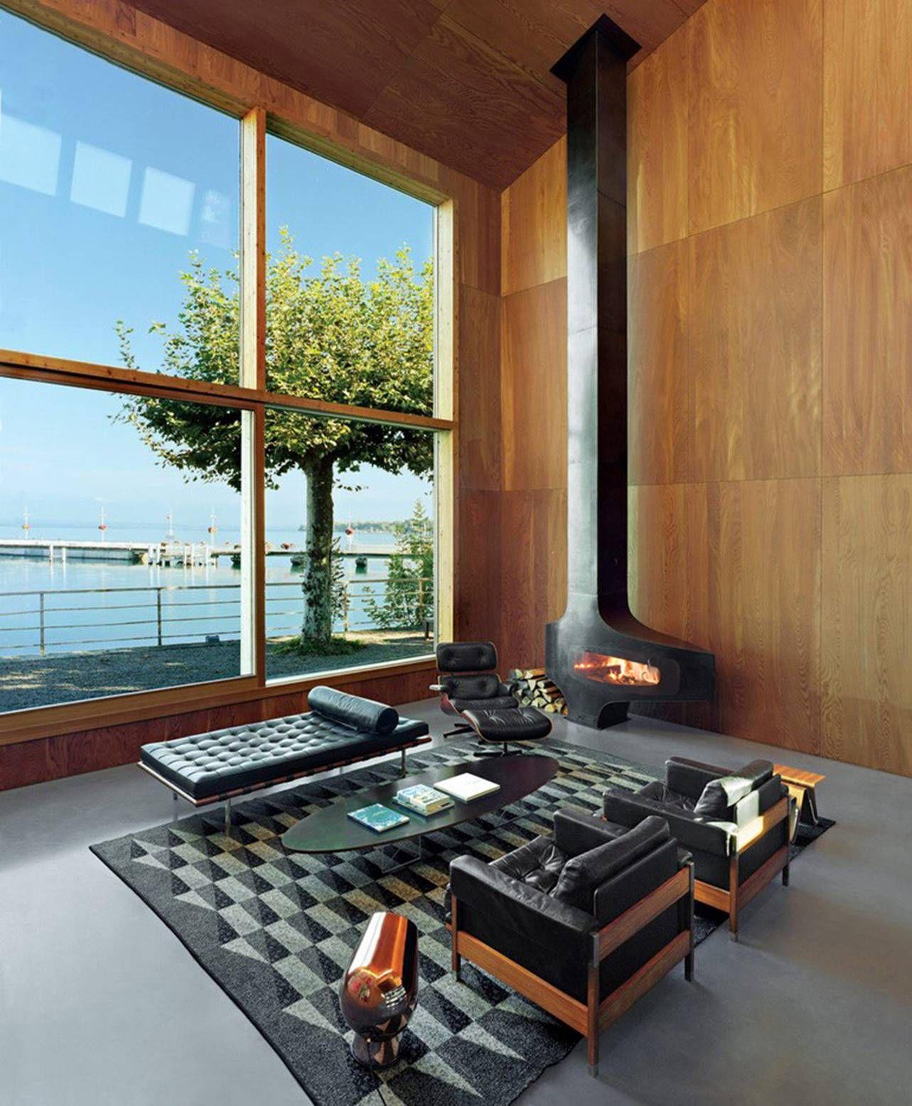 Salon Au Style Contemporain Qui Melange Canape En Cuir Noir Et Mur