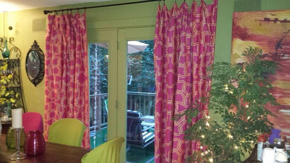 Cool curtains are hard to find.  I saw this orange and hot pink pattern on a twin duvet cover on sale for $15 at BB&B and fell in love. These are twin extra long.   The other side is solid orange.  A duvet is heavy enough to hang well, so I tried it on my back door.  Worked great!  Went back and got a plain black and red flowered 2-sided regular twin duvet.  Fits great.  Six duvets,  3 poles and rod clasps I already had. Total cost under $100.