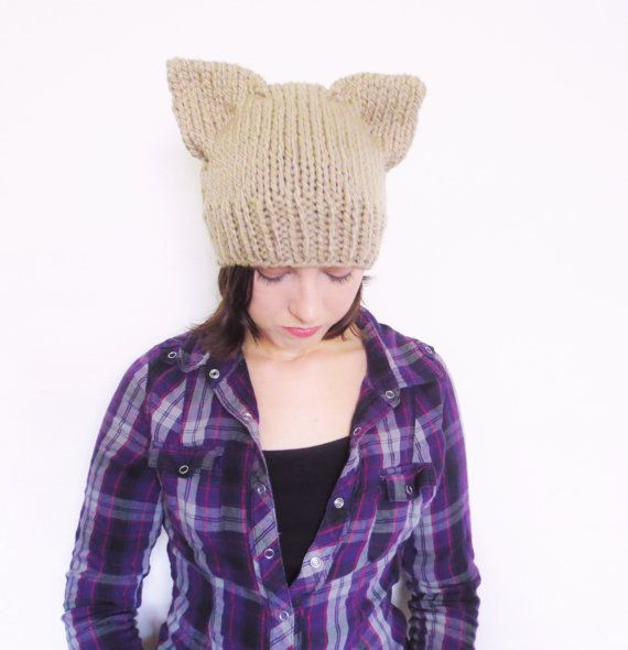 Taupe greige hand knit cat ear beanie  Spice up your accessories with this cute cat ear beanie! ► Knit with chunky yarn to keep you warm in cold weather ► Ears are sewn down so you dont have to create the ear shape everytime you put it on ► The ears have a natural cat-like shape; they arent completely flat ► Made with 100% acrylic yarn ► Machine washable and dryable  Sizing: Adult/teenage; one size fits most. If you would like to request a smaller or larger size then just send me a message…