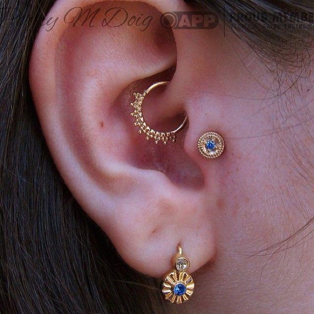 beautiful elegant matching golden daith and tragus piercings                                                                                                                                                     Plus