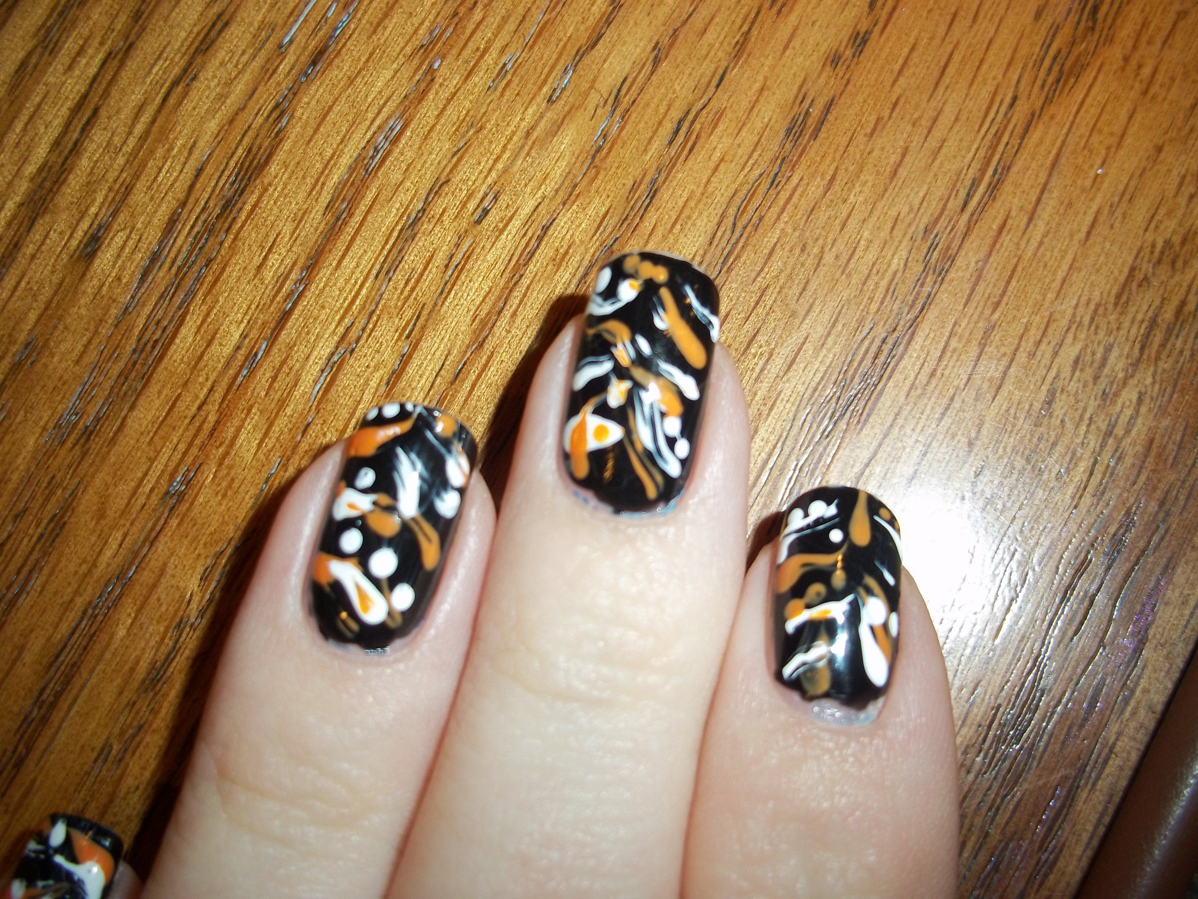 Halloween nails Paint your nails black and let them dry ...