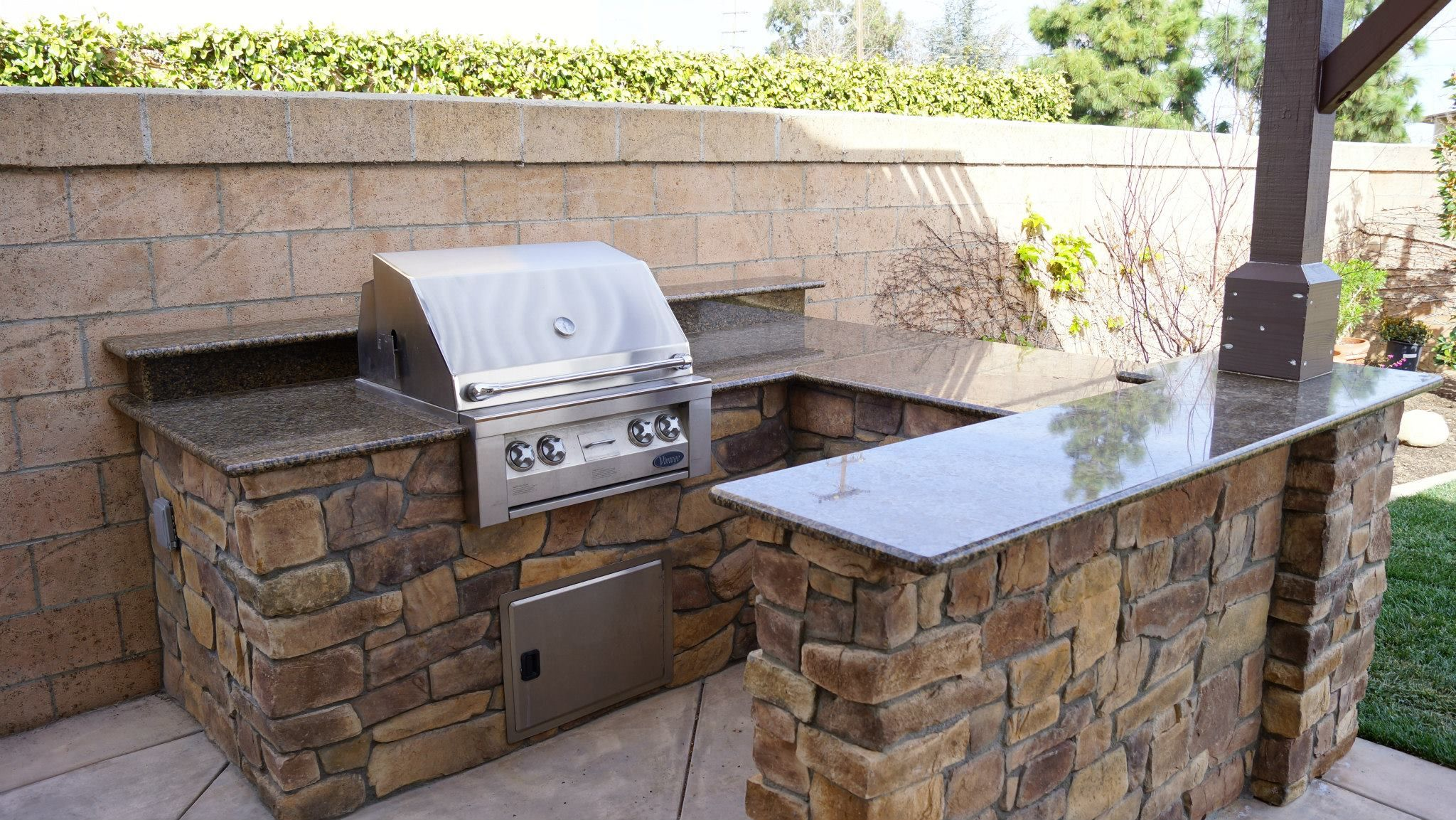 Renovated Outdoor Kitchen Island with new Raised Bar Faux Stone