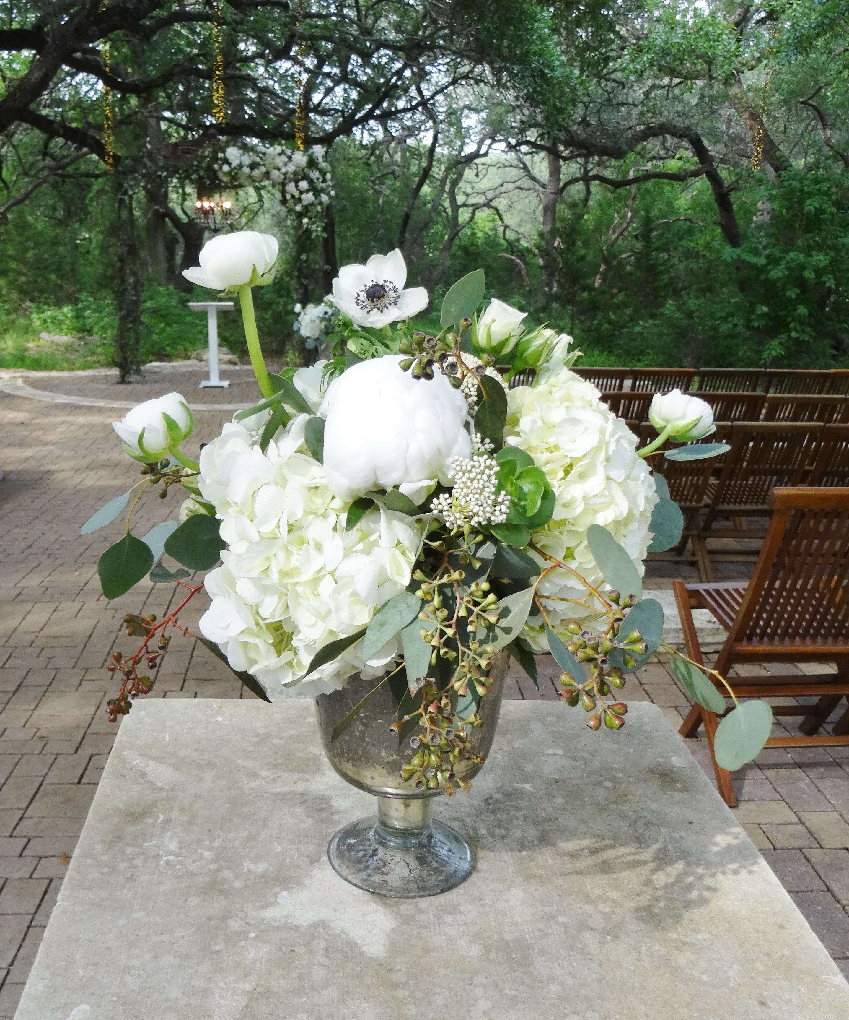 White ranunculas, peonies and hydrangea at Sacred Oaks Ceremony Site.