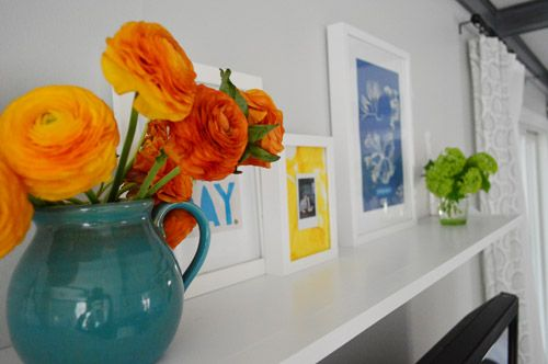 Young House Love - Beautiful Flowers - Ranunculus - on Shelf above TV