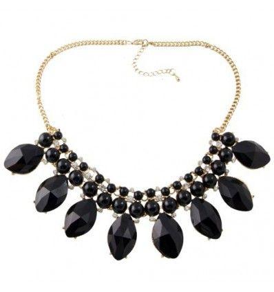 20403f370f55 Collar tipo gargantilla con base color dorado formado piedras negras en  forma de óvalo y pequeñas semiesferas negras combinadas con pequeños  cristales.
