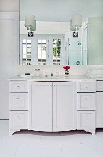 Custom Bow Front Vanity Cabinet With Sconces And Wall Mirror