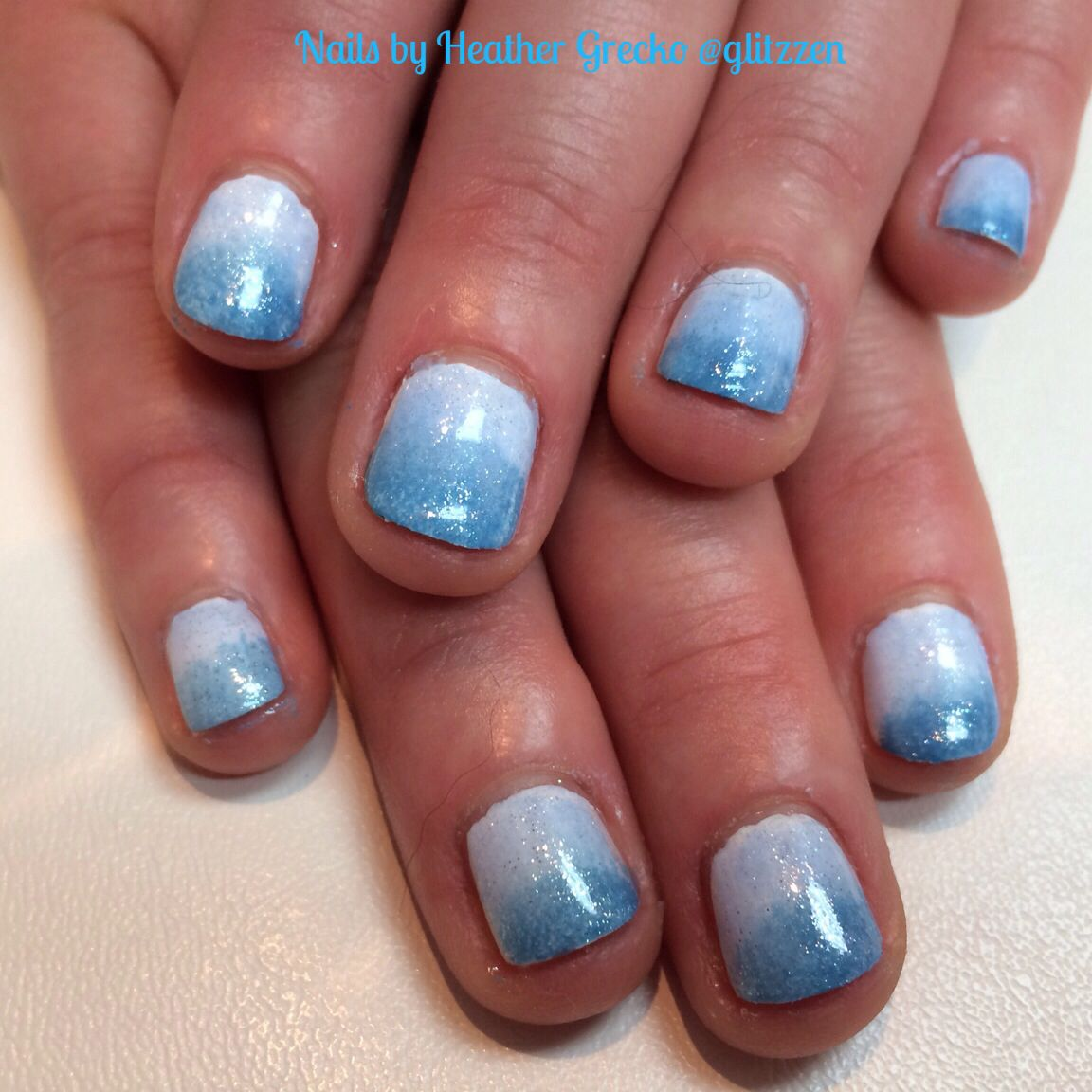 Natural nail manicure with LCN\'s. Polish in denim blue and frosted ...