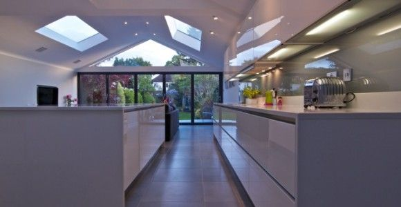A Contrasting Contemporary Kitchen Extension, With A Unique Glass Gable  Feature Within The Roof Construction
