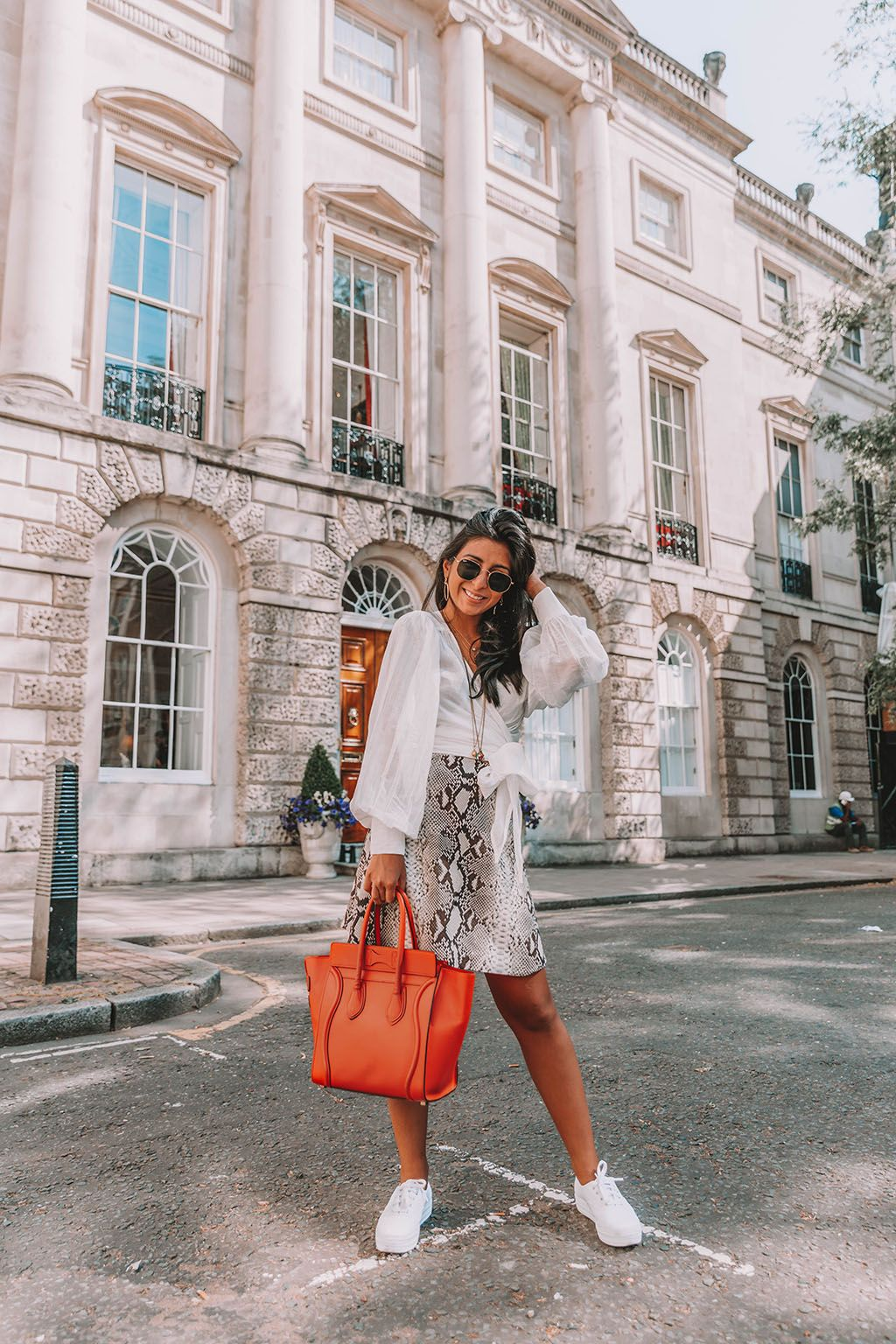 f1a6bc88f554b6 Fashion blogger Shloka Narang of The Silk Sneaker shares the summer blouse  you need to create a cute summer outfit featuring ba&sh, Celine and Ray-Ban