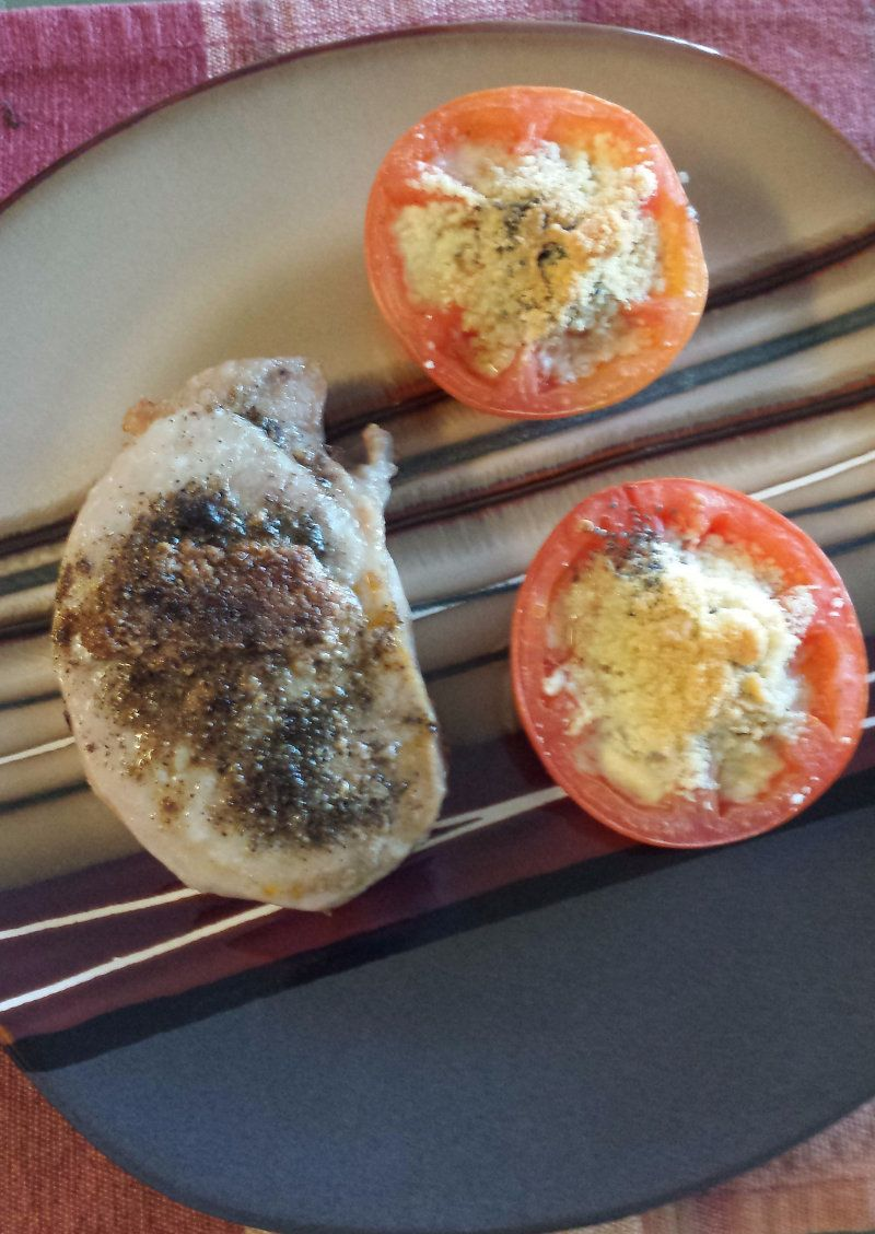Stuffed pork Chops with cooked tomatoes