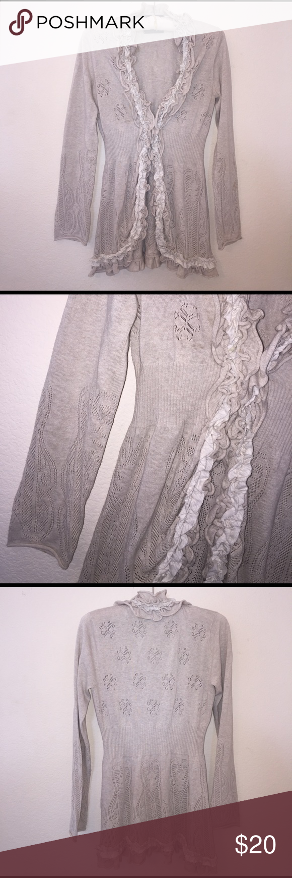 Anthropologie Cardigan Brand: Guinevere. Great condition cream cardigan with clasp at center. Size is a L. Feel free to ask any questions! Anthropologie Sweaters Cardigans