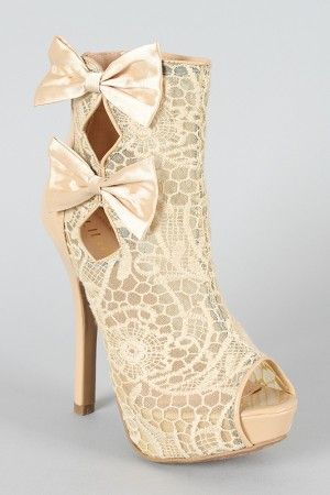 I love the lace on these heels, I want them!