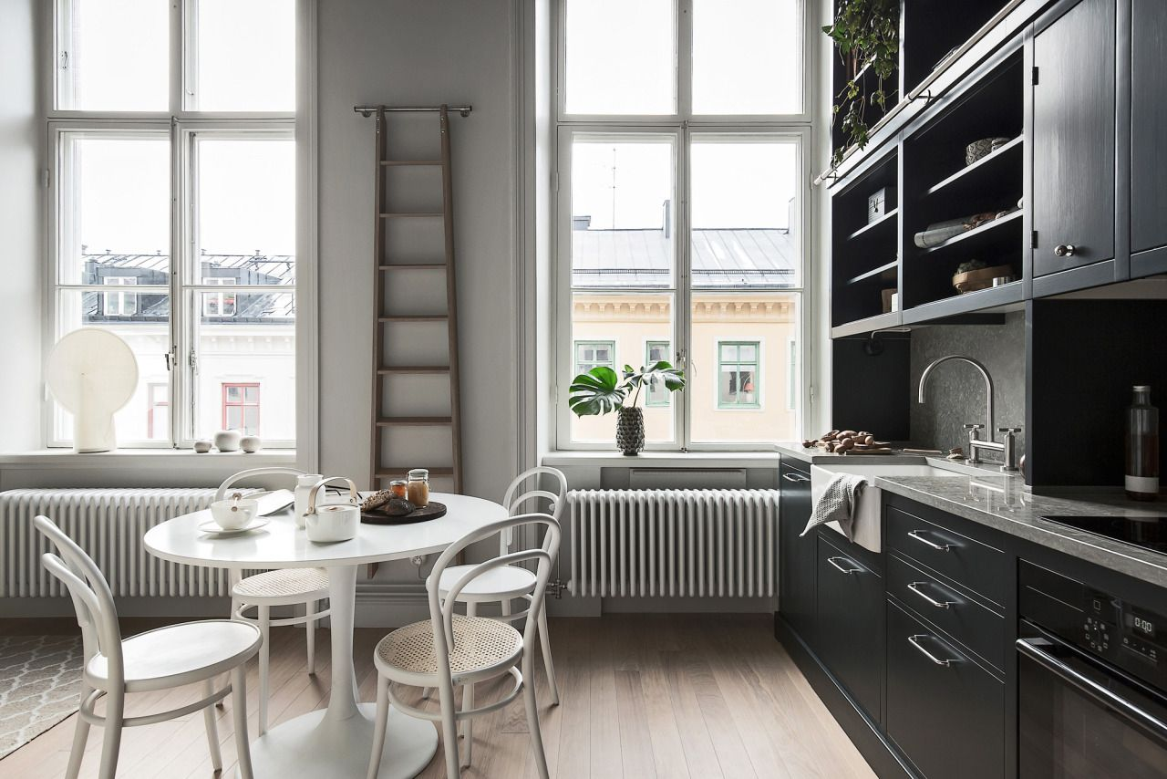 Small loft with black kitchen Follow Gravity Home Blog