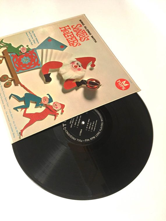 The Pixie Helpers And Santa Claus – Sing Along With Santas Helpers  Label: Tops Records – L 1700 Format: Vinyl, LP, Album Country: US Released: 1959 Genre: Childrens, Folk, World, & Country Style: Folk  Tracklist:  A1 Rudolph The Red-Nosed Reindeer A2 Sleigh Ride A3 The Animals Christmas Song Medley A4.1 O Come All Ye Faithful A4.2 Silent Night A5 I Saw Mommy Kissing Santa Claus B1 Frosty The Snow Man B2 The Christmas Song B3 Joy To The World B4 Jingle Bells B5 Deck The Halls  Condition…