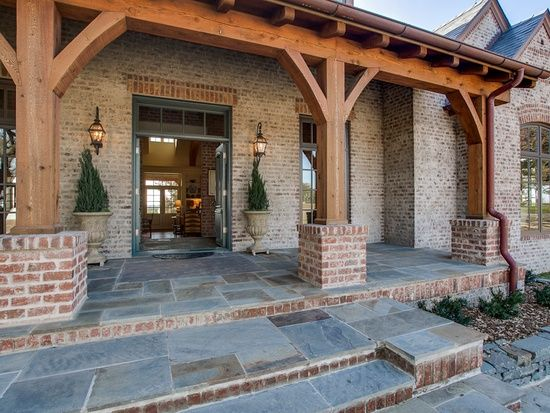 Washed Brick And Dark Metal Roof Exposed Beam Front Porches Hill Country Homes House With Porch House Exterior