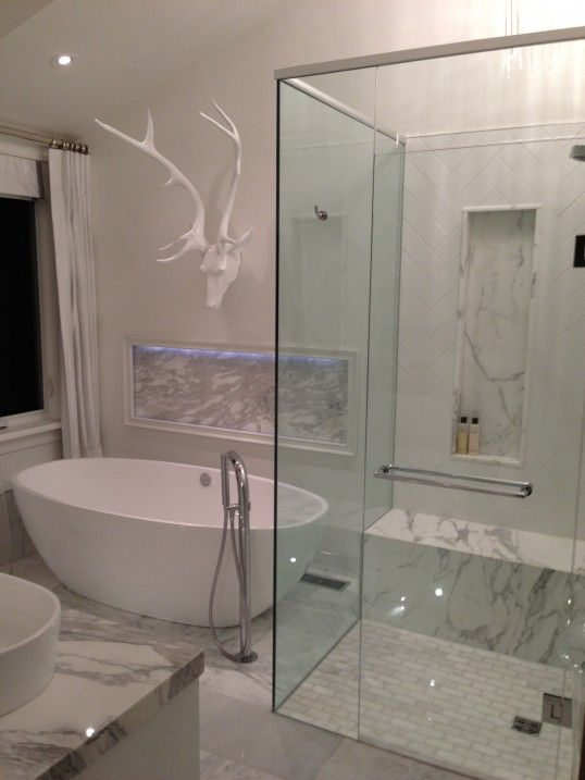 The generously sized Barcelona freestanding bath by Victoria + Albert as shown here in this stunning white bathroom and positioned with the Tubo bath filler. Bathroom designed by Andrew Pike (Ontario, Canada).