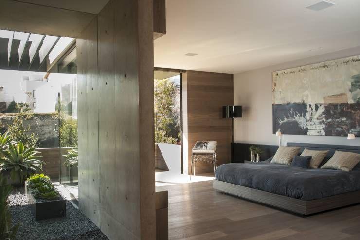 Casa ML: Recámaras de estilo Moderno por Gantous Arquitectos