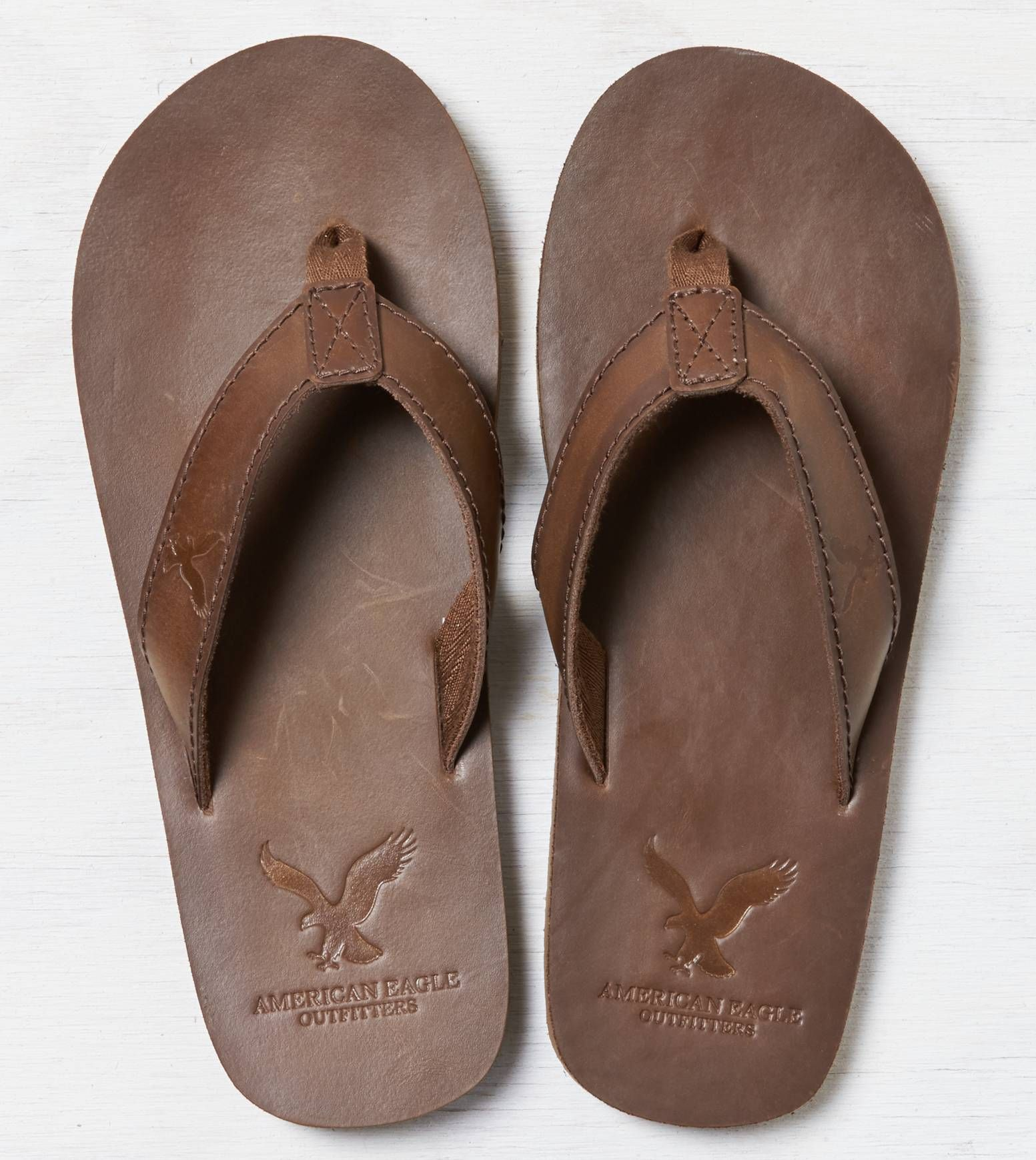65a369c26ba84b Brown AEO Leather Flip Flop. Show us your  AEOSTYLE on Instagram or Twitter  for a chance to be featured on AE.com.
