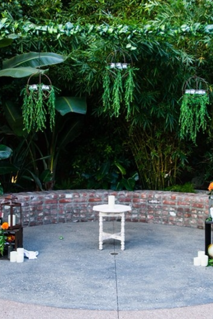 Instead of a traditional arbor, you can use greenery for a more natural backdrop to your ceremony.