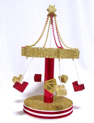 Carnival Swing Centerpiece looks like a carnival ride. DIY kits make it easy to decorate