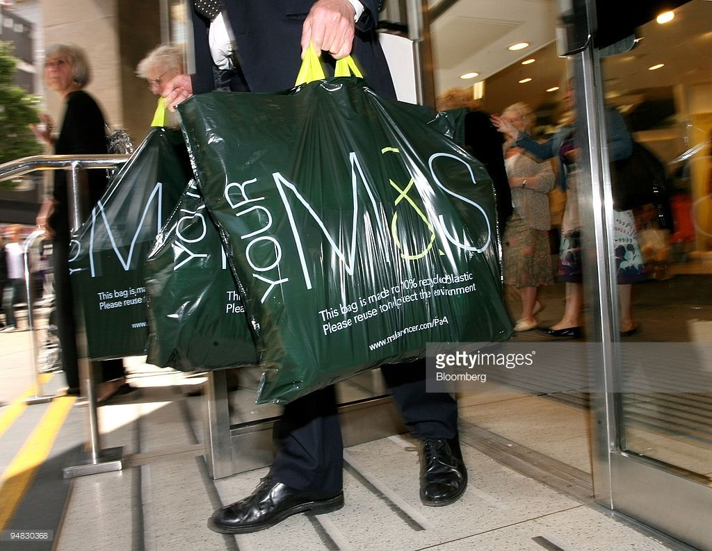 A Customer Carrying Shopping Bags Leaves A Marks Spencer Store In Spencer Store Marks And Spencer Bags