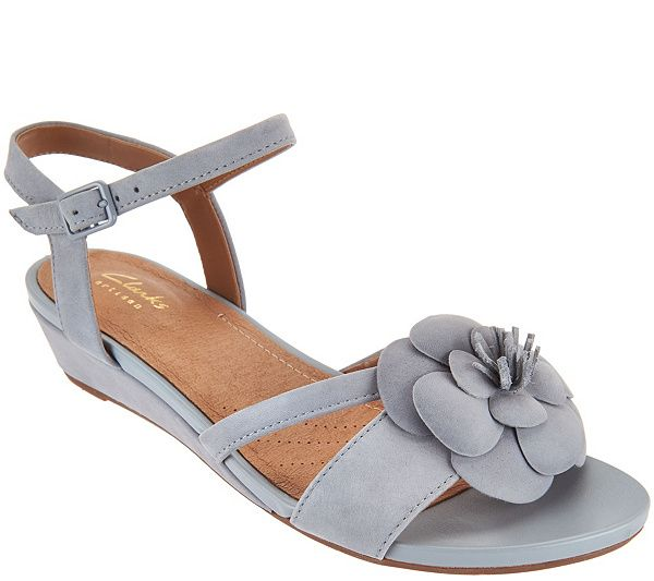 e58f5df81301 Flower power. These nubuck wedges by Clarks are in full bloom with an  oversized flower embellishment on the open toe. QVC.com