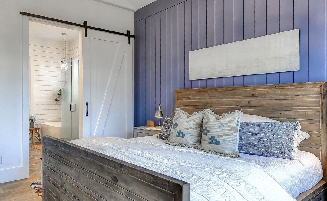 Bringing in texture and depth to the design with a little help from a great shiplap layout. The dark tone of the shiplap builds a great foundation to bring in lighter colors and softer textures. This contrast creates a comfortable and cozy aesthetic that's just perfect for a master bedroom.Photo: @milesminnophotography#bedroominspiration #modernfarmhouse #luxurydesigns #modernbedroom #houseinthehills #dreamhome #familyfarmhouse #customdesign #bedroomdesign #interiordesigns #colorfuldesign #luxur