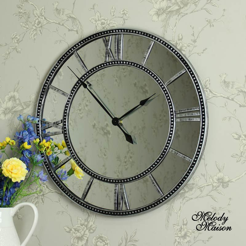 Large Mirrored Wall Clock large mirrored skeleton style wall clock with roman numerals